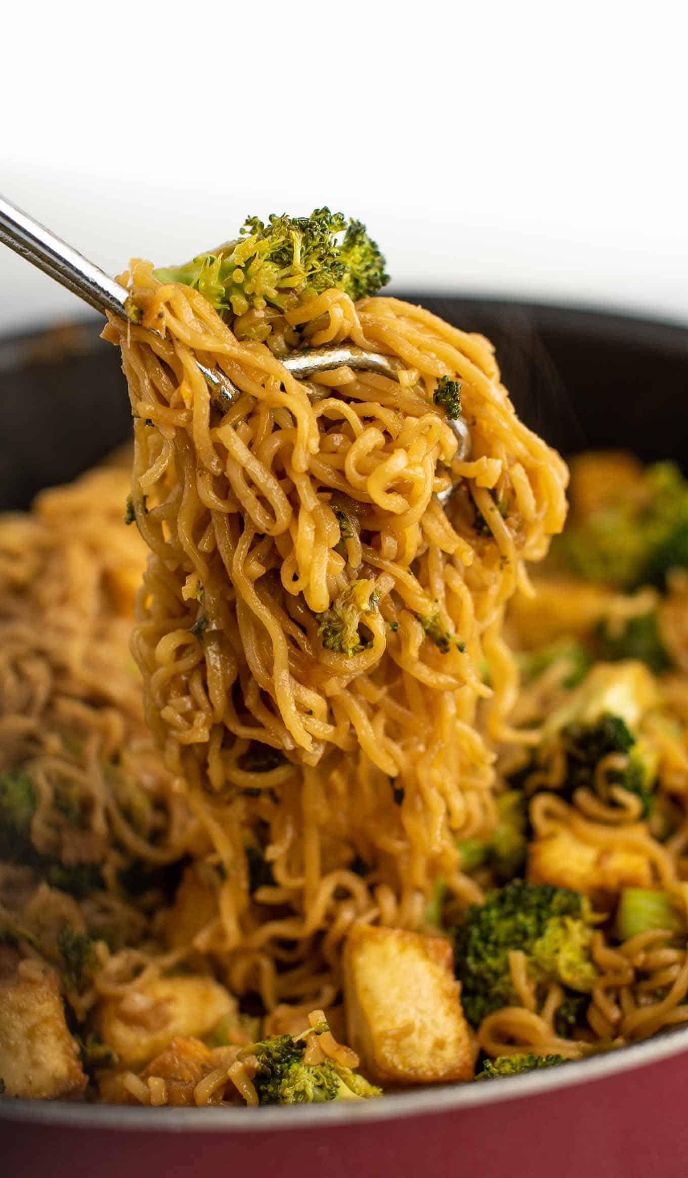 tongs grabbing the ramen noodles