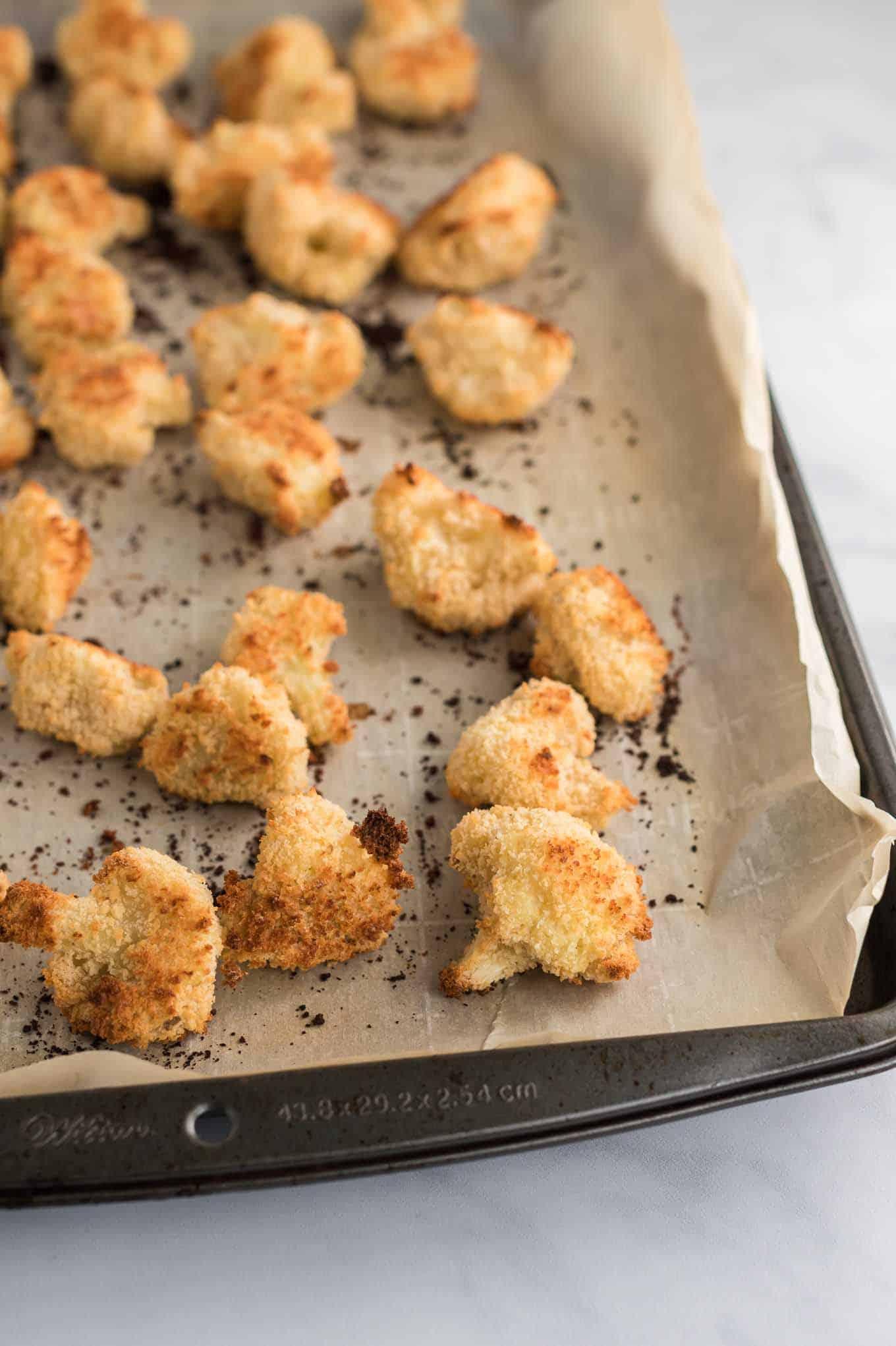 the cooked crispy cauliflower bites on the baking sheet