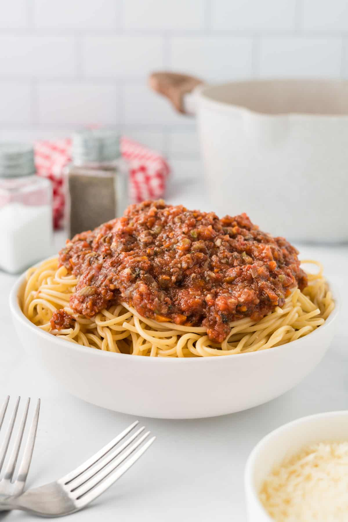 bowl of spaghetti topped with vegetarian bolognese sauce