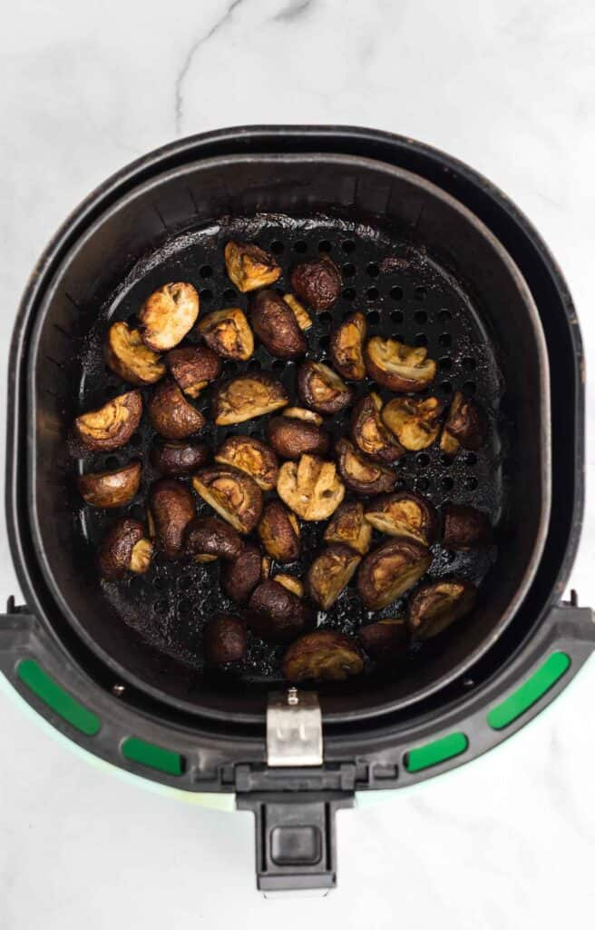 roasted air fryer mushroom in the air fryer basket