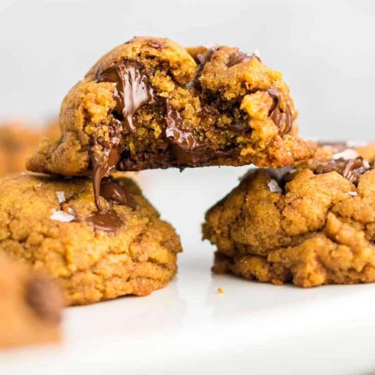 vegan pumpkin chocolate chip cookie with a bite taken out