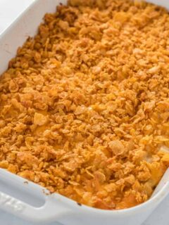 finished cheesy potato casserole with cornflake topping