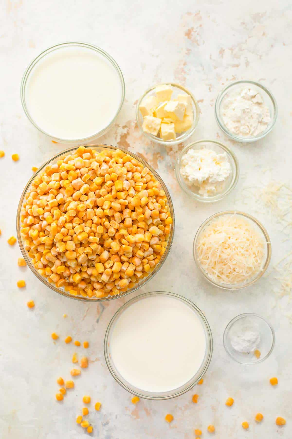 ingredients to make creamed corn in glass bowls