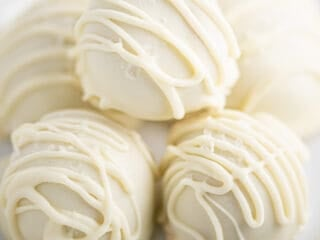 white chocolate balls stacked on a white plate