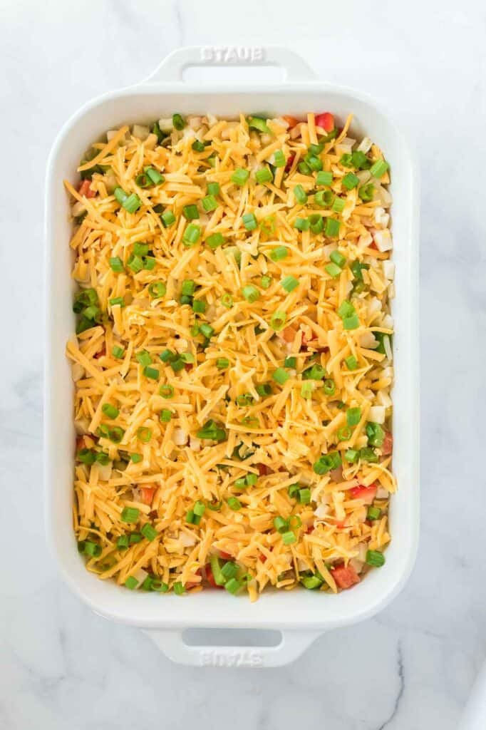 casserole topped with sharp cheddar cheese and green onions