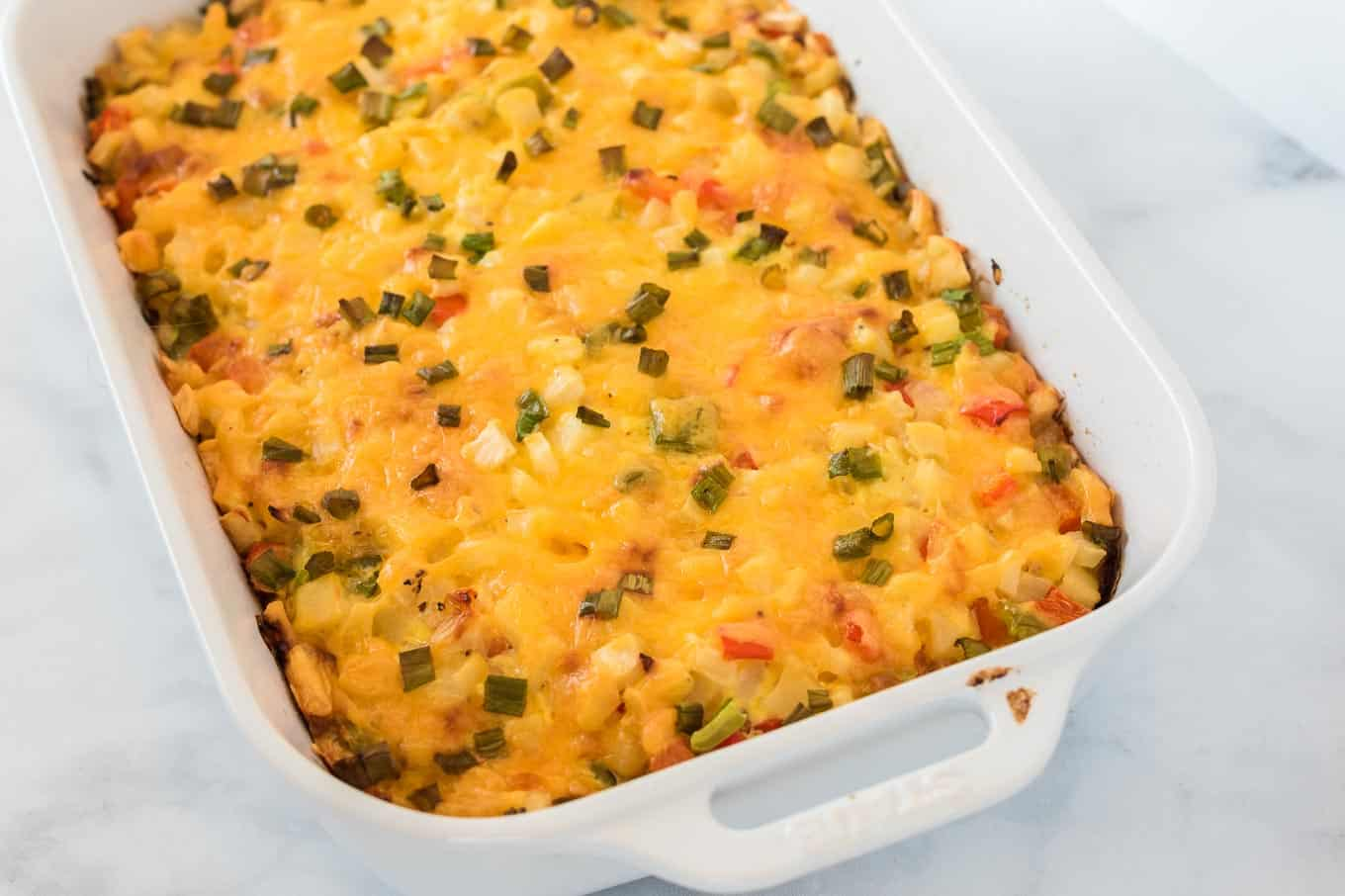 finished baked hash brown egg casserole in a white dish