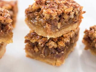 pecan pie bars stacked on top of each other