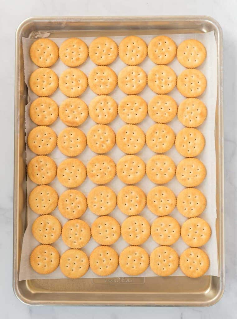 a baking sheet lined with ritz crackers