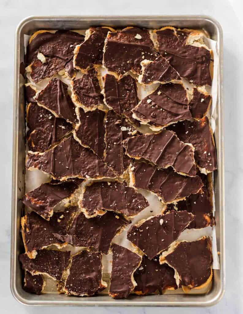 sheet pan with broken up ritz cracker toffee candy