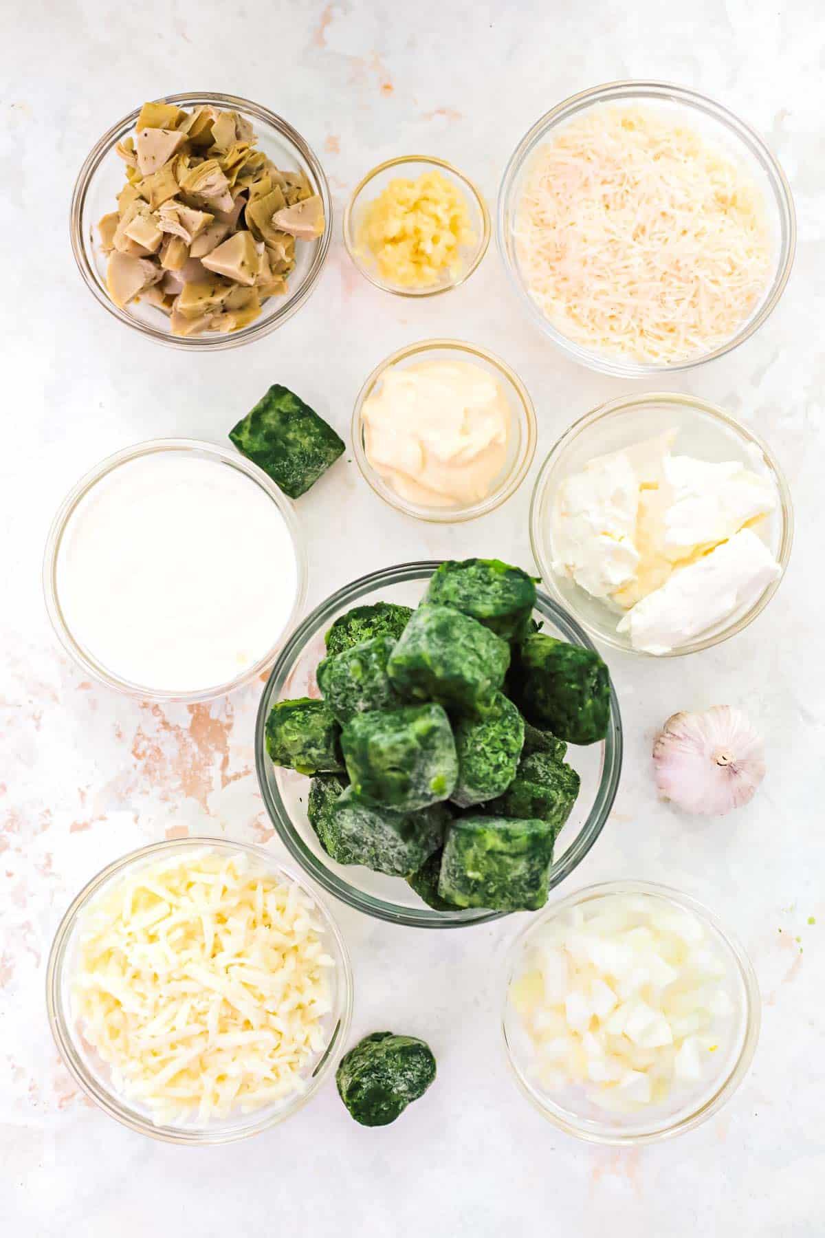 spinach artichoke ingredients in bowls