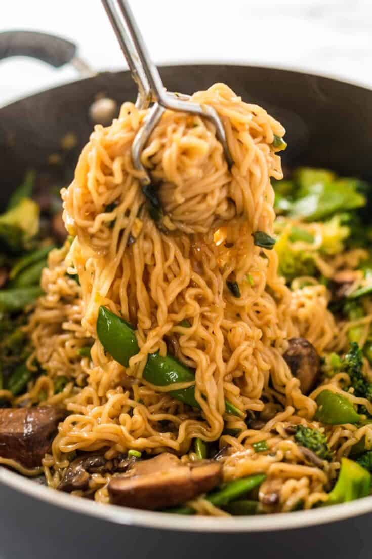 grabbing a serving of teriyaki noodles