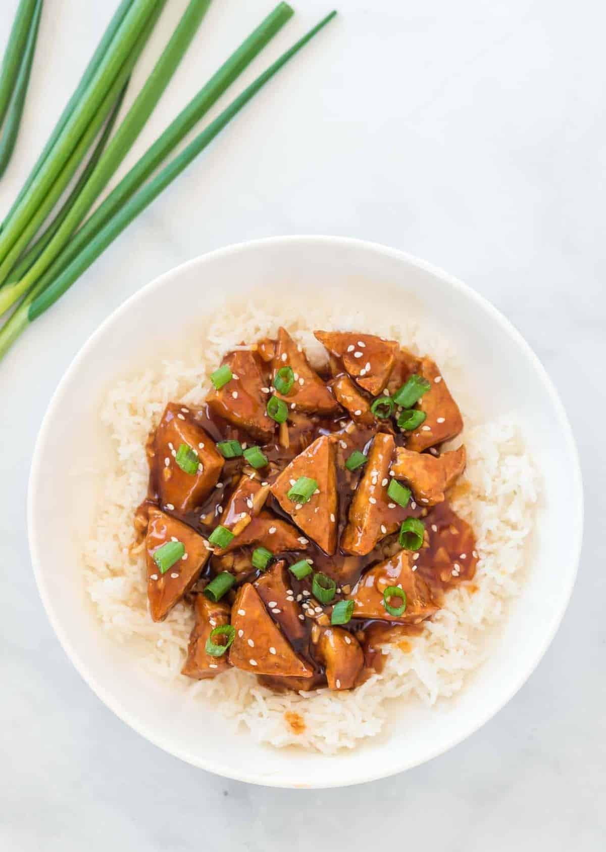 teriyaki tofu over white rice in a bowl