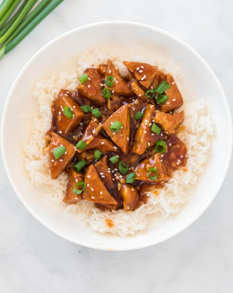 teriyaki tofu over white rice in a bowl