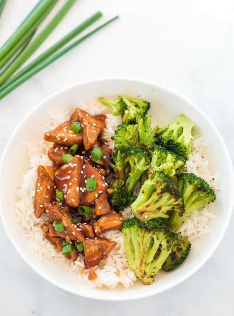 teriyaki tofu with broccoli over white rice in a bowl