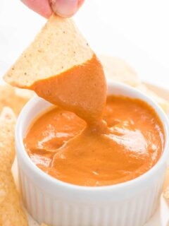 chip dipped in vegan queso