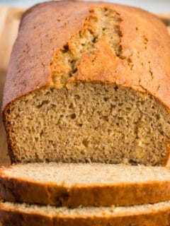 banana bread loaf being cut into slices