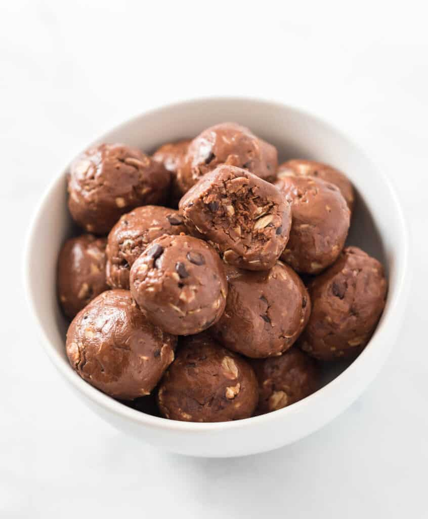 chocolate energy balls in a white bowl