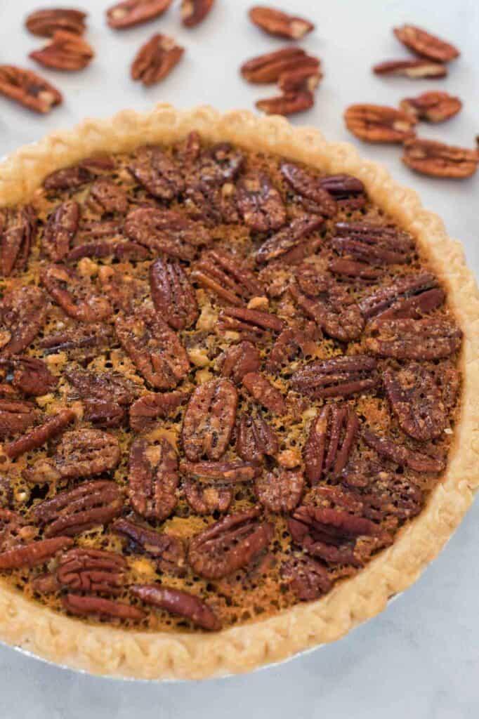 pecan pie surrounded by pecan halves