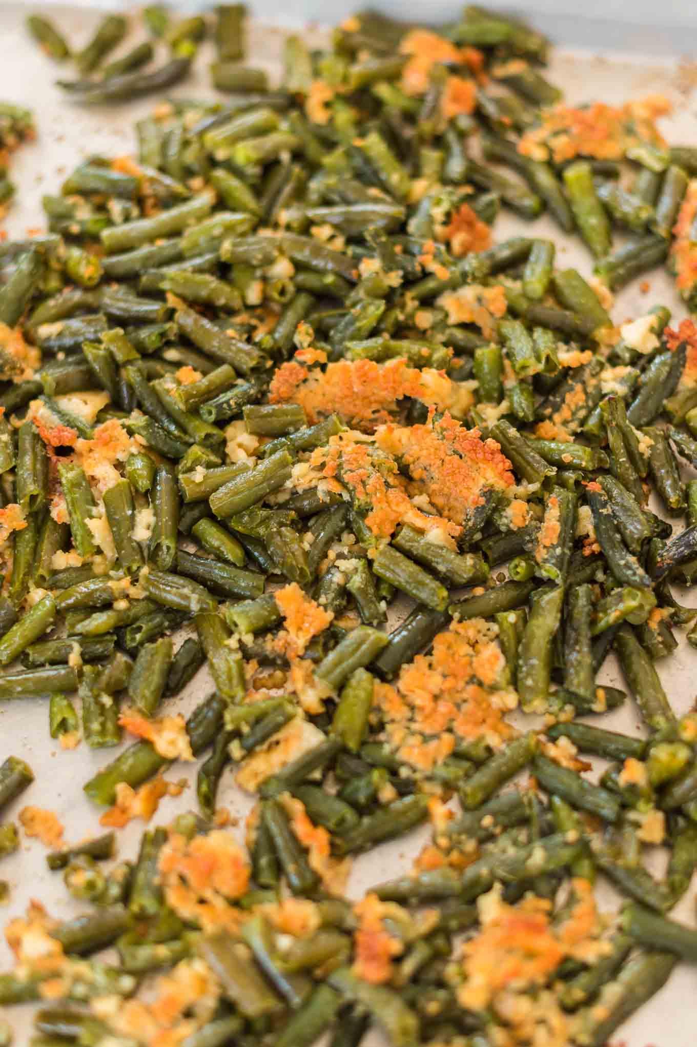 roasted frozen green beans on a baking sheet