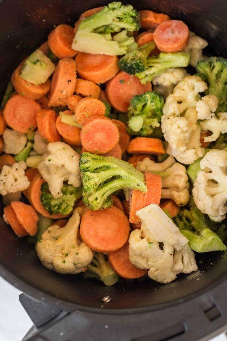 frozen mixed vegetables in an air fryer basket