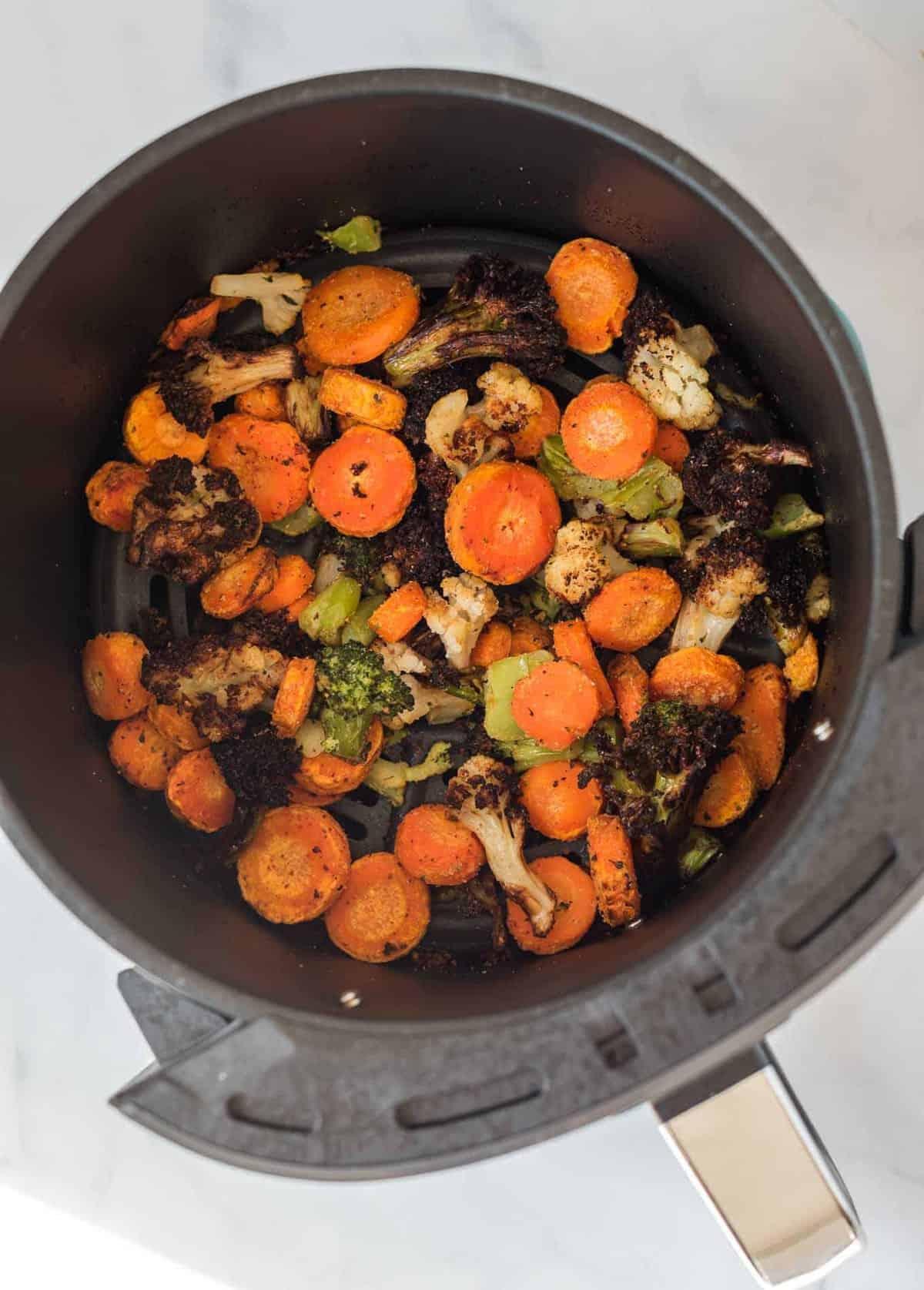 air fried crispy frozen vegetables in the air fryer basket