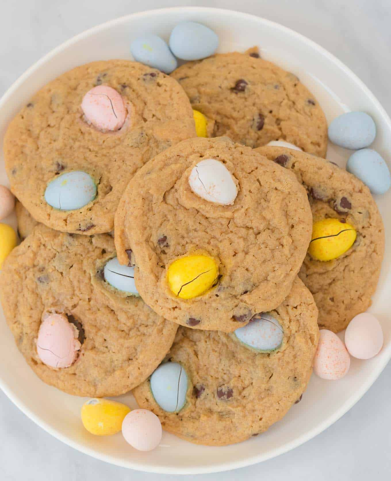 cadbury cookies on a white plate surrounded by mini cadbury eggs