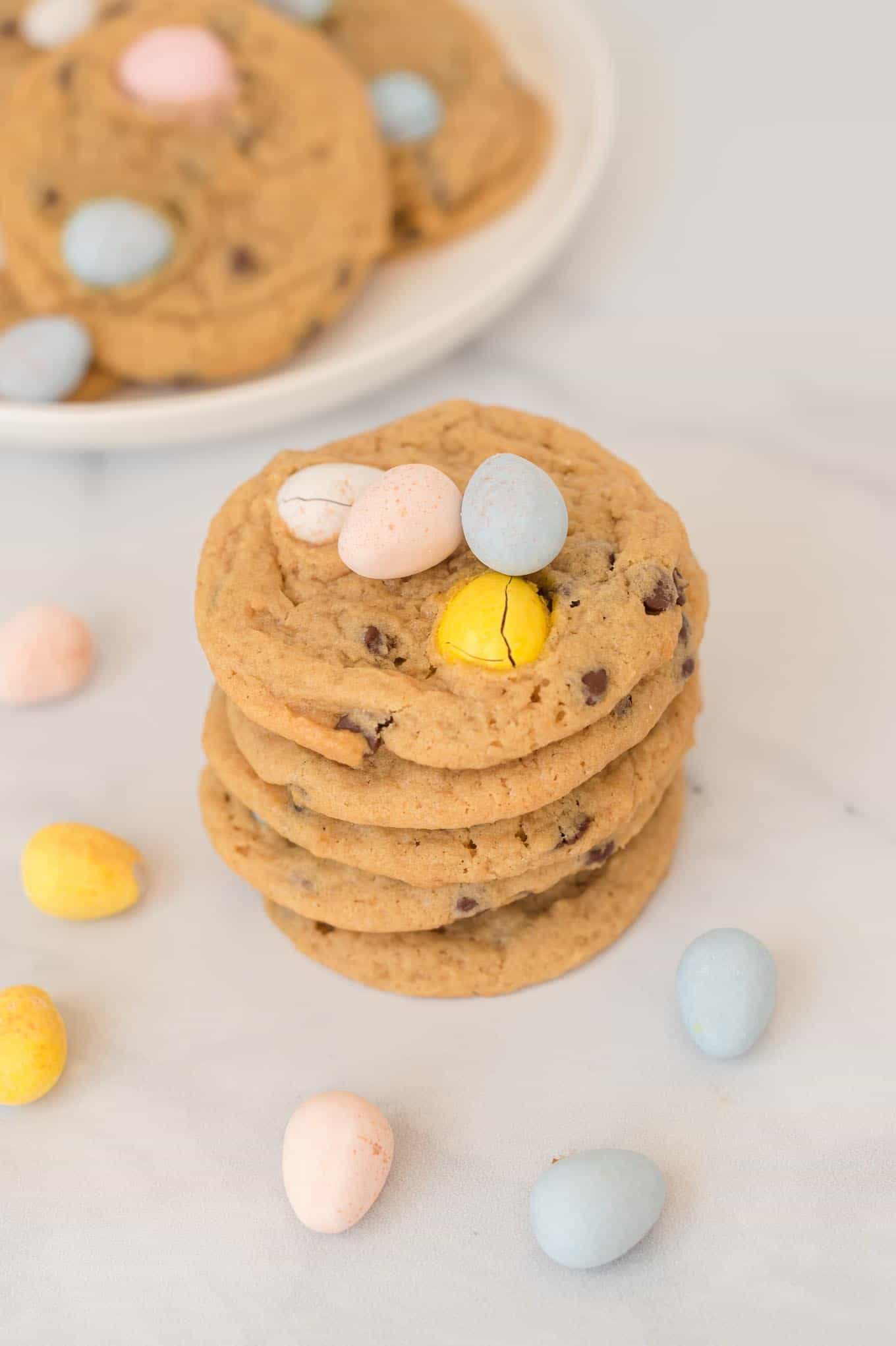 5 cadbury mini egg cookies stacked on top of each other