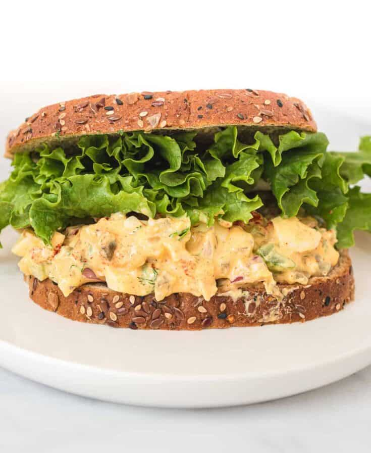 healthy egg salad sandwich with lettuce on top