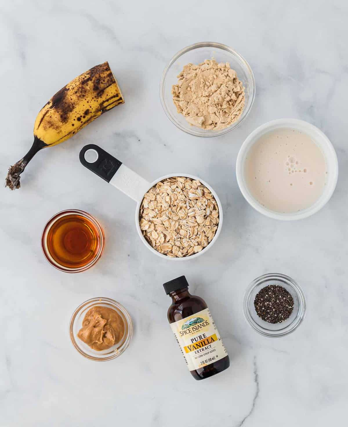 ingredients for overnight oats laid out on a marble background