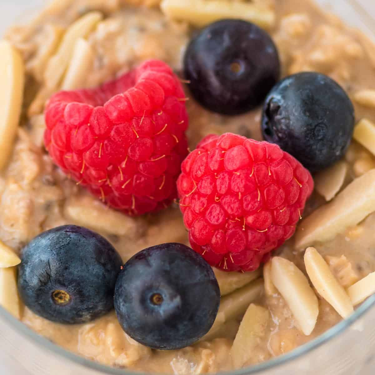 overnight oats topped with raspberries and blueberries