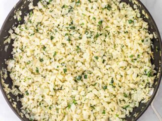 cilantro lime cauliflower rice in a skillet