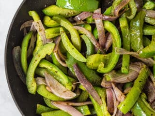 cooked fajita veggies in a skillet