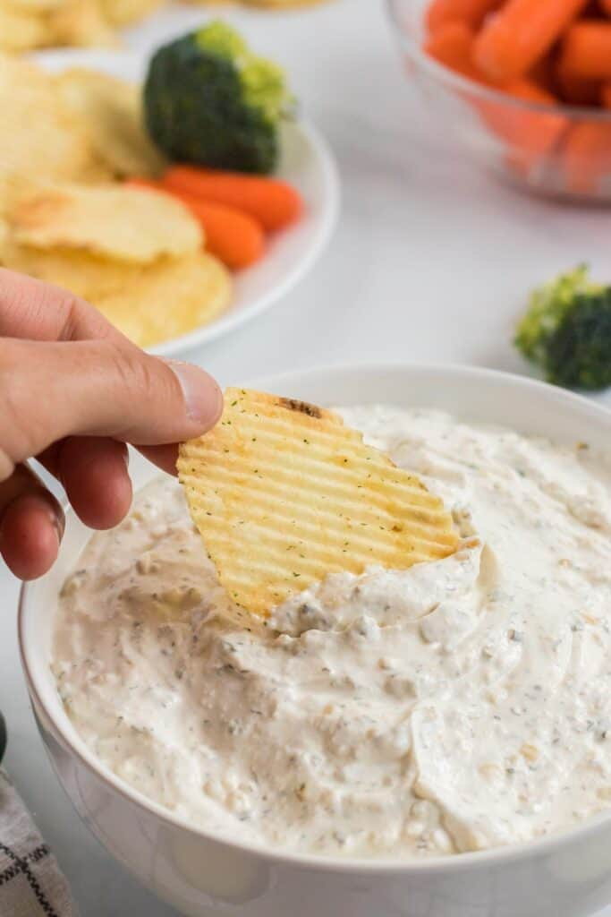 chip being dipped into a chip dip