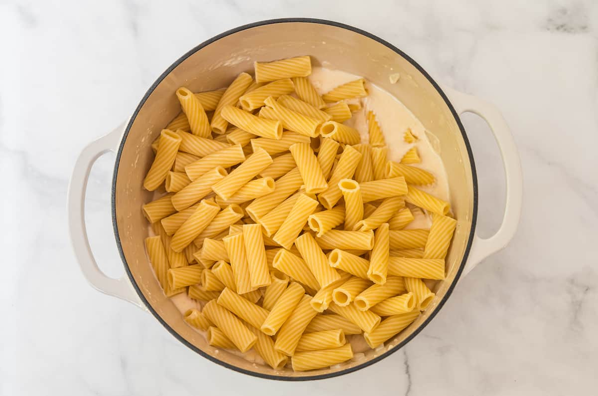cooked rigatoni noodles in a white dutch oven