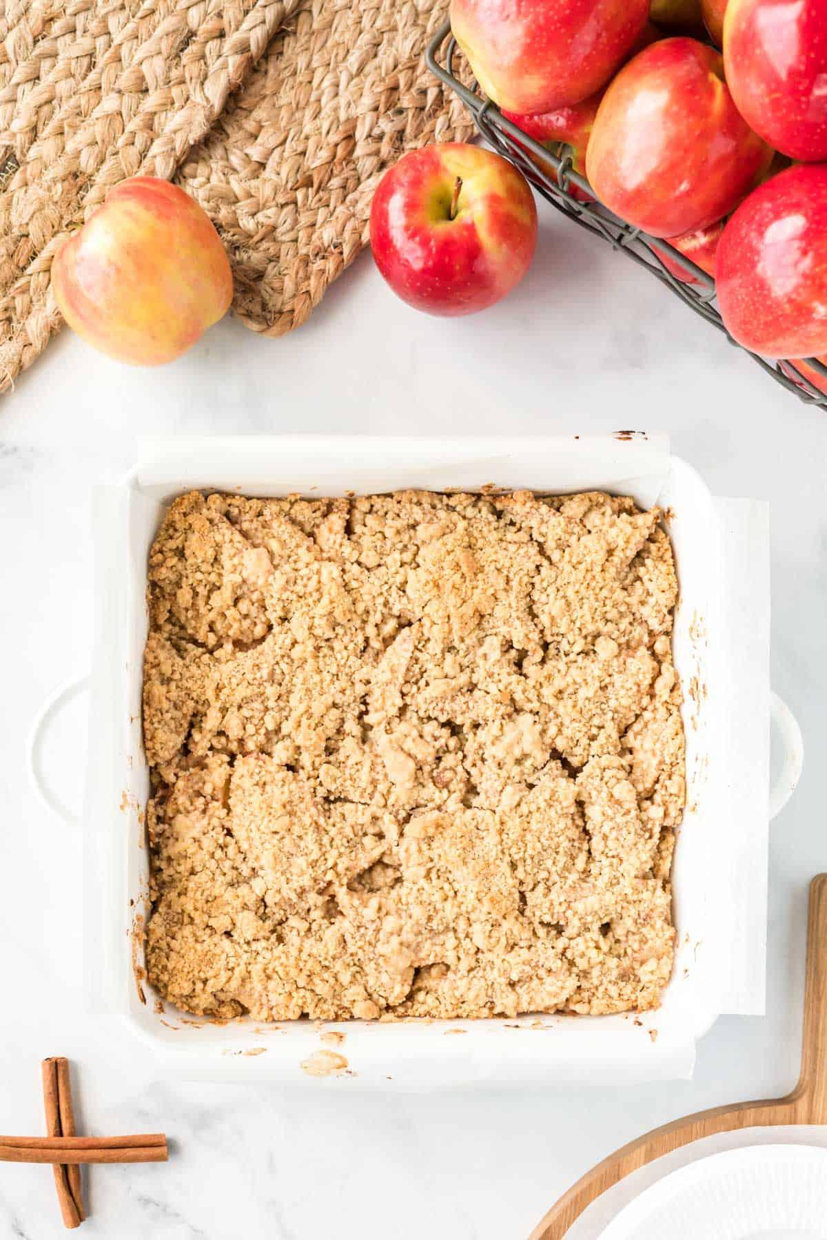 apple crisp bars in a white square baking dish