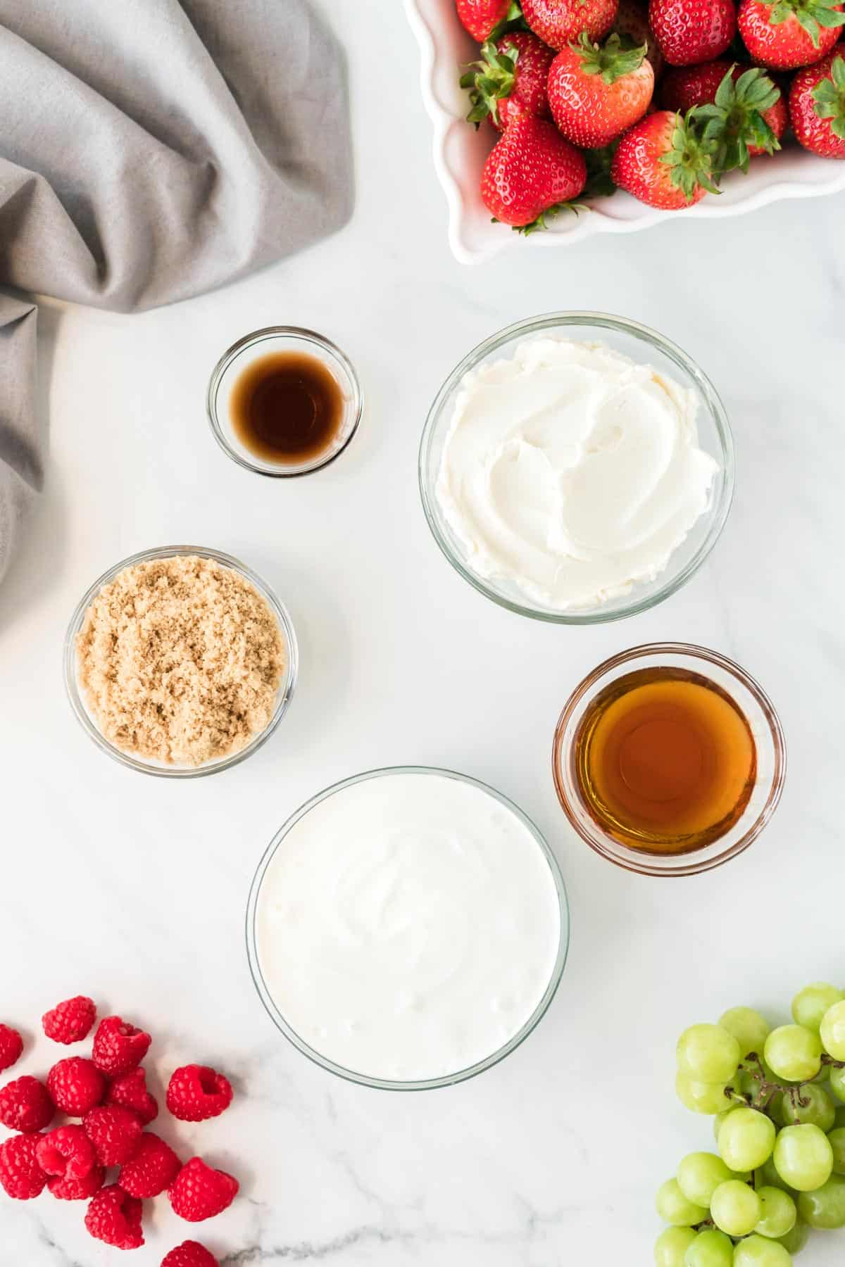 cream cheese fruit dip ingredients in glass bowls