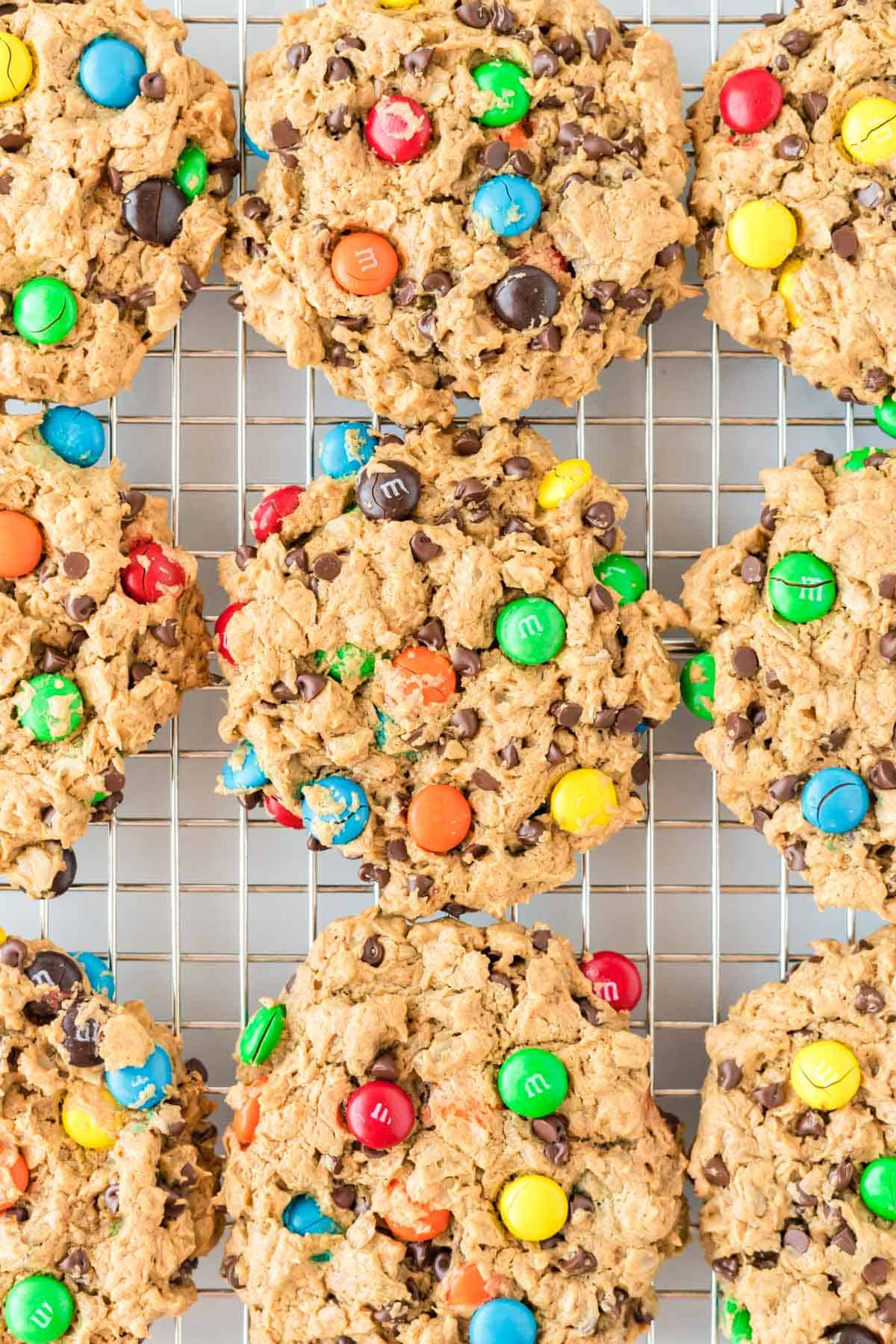 flourless monster cookies on a wire cooling rack