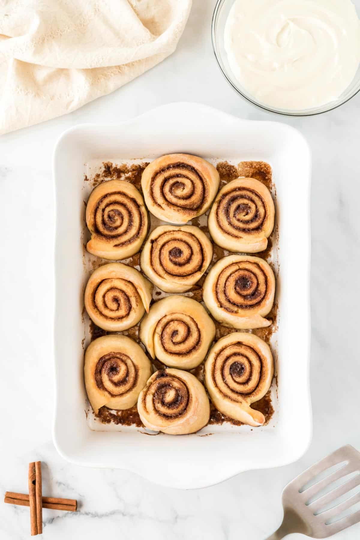 cinnamon rolls in a baking dish after baking