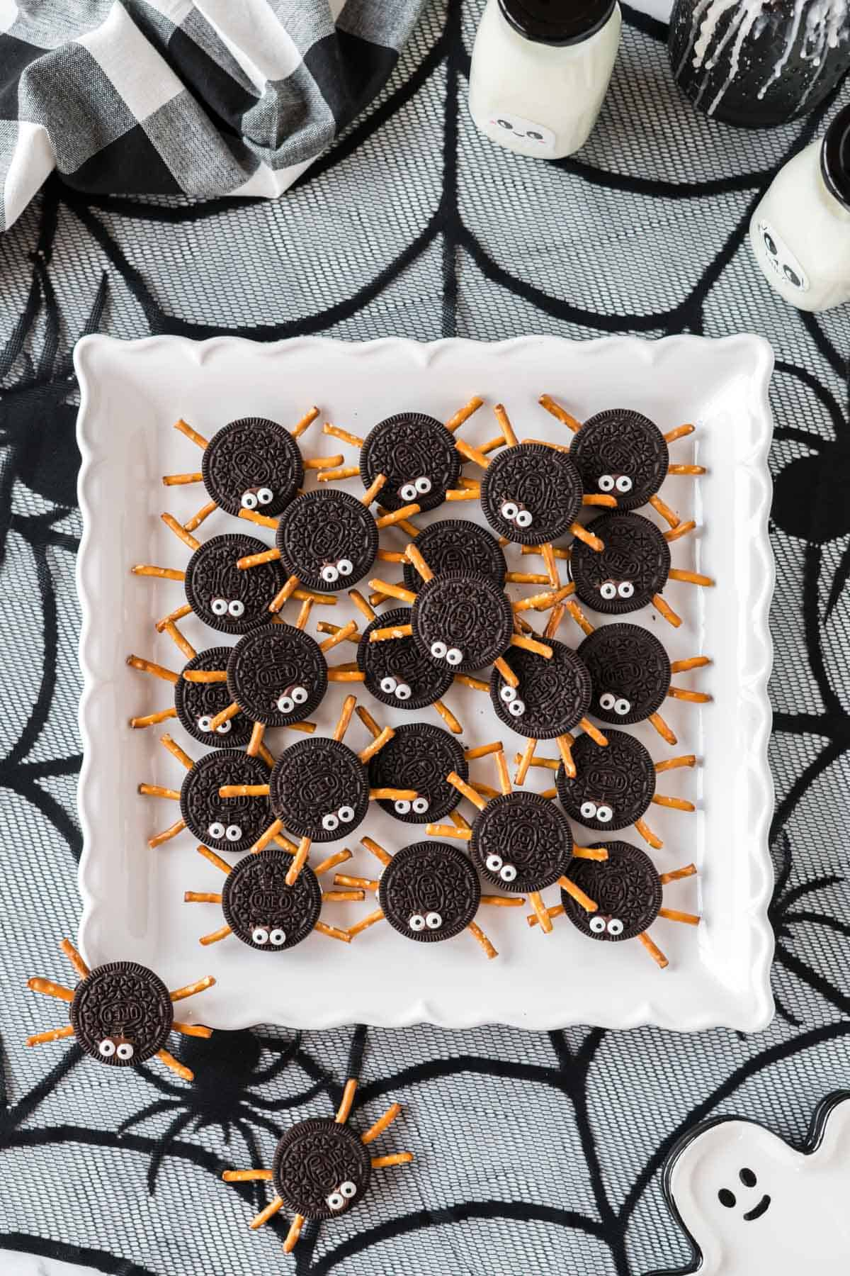 spider cookies on a white tray