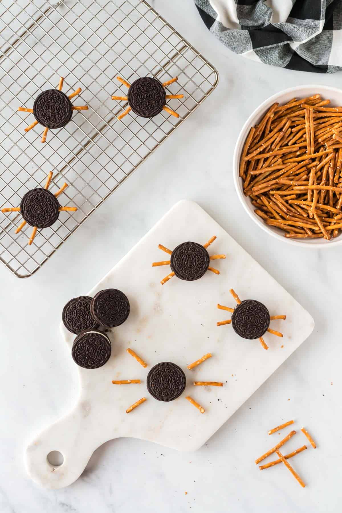 placing the pretzels into the oreo cookie