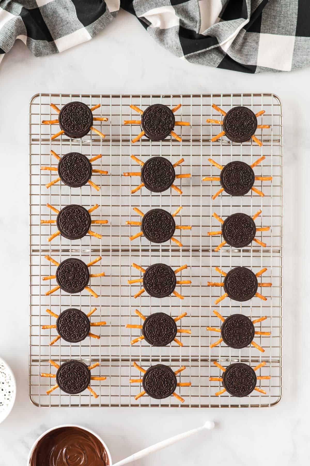 oreo cookies with pretzel legs