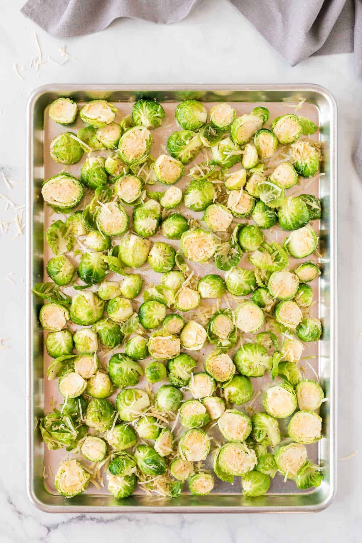 raw brussels sprouts on the baking sheet