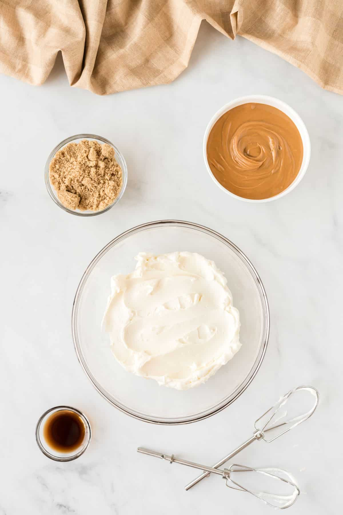cream cheese, peanut butter, and sugar in bowls