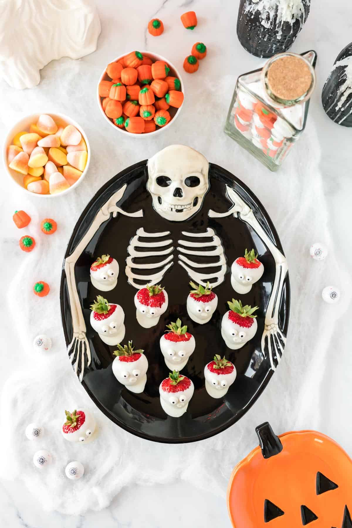 skeleton tray with strawberry ghosts on it