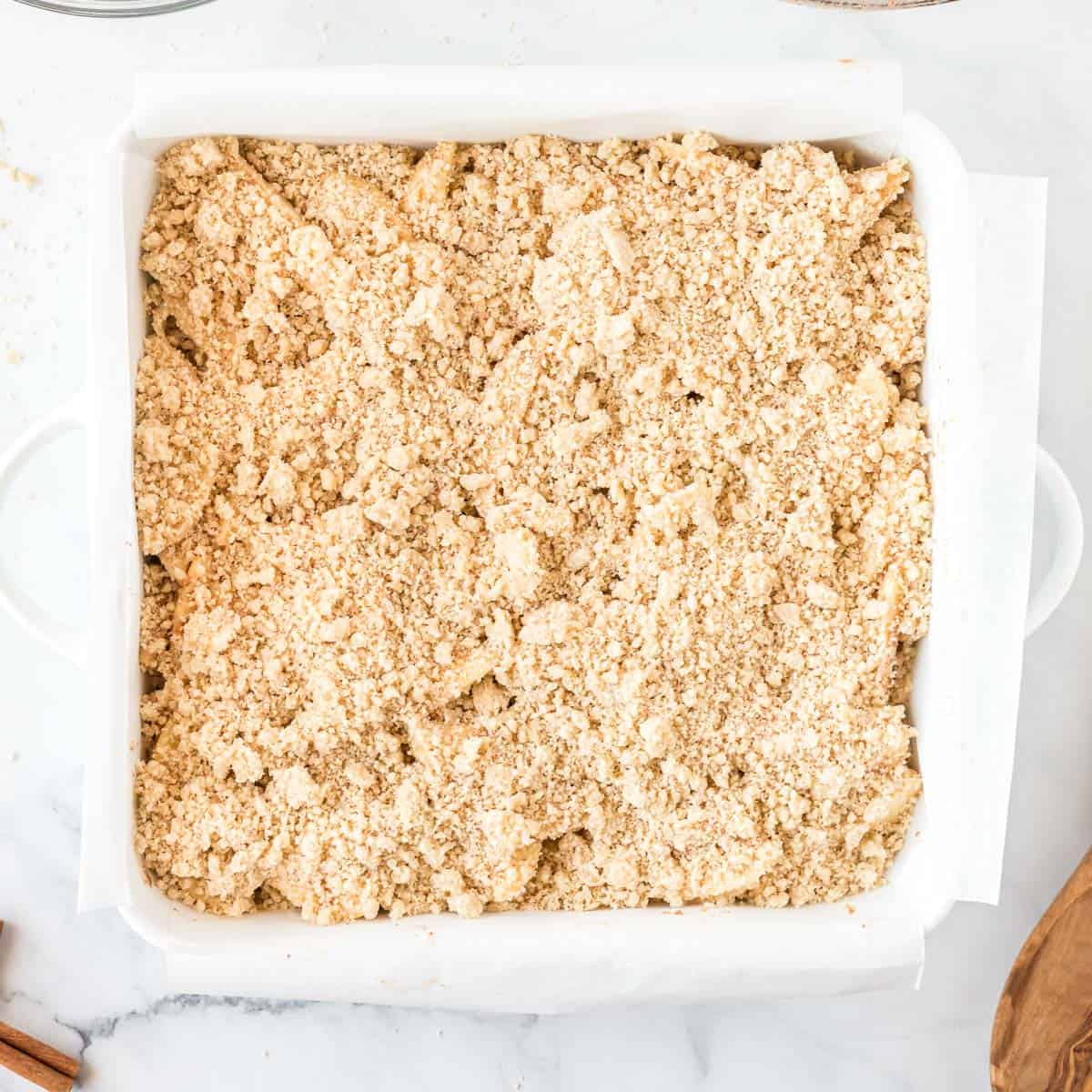 crumb topping added to the apple crisp bars in the pan
