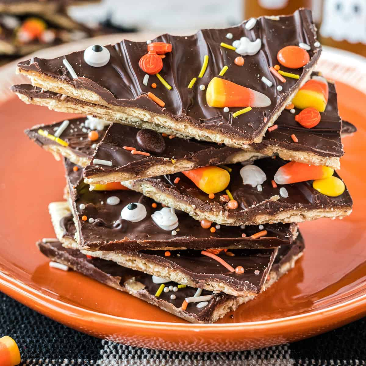 halloween crack candy pieces stacked on an orange plate