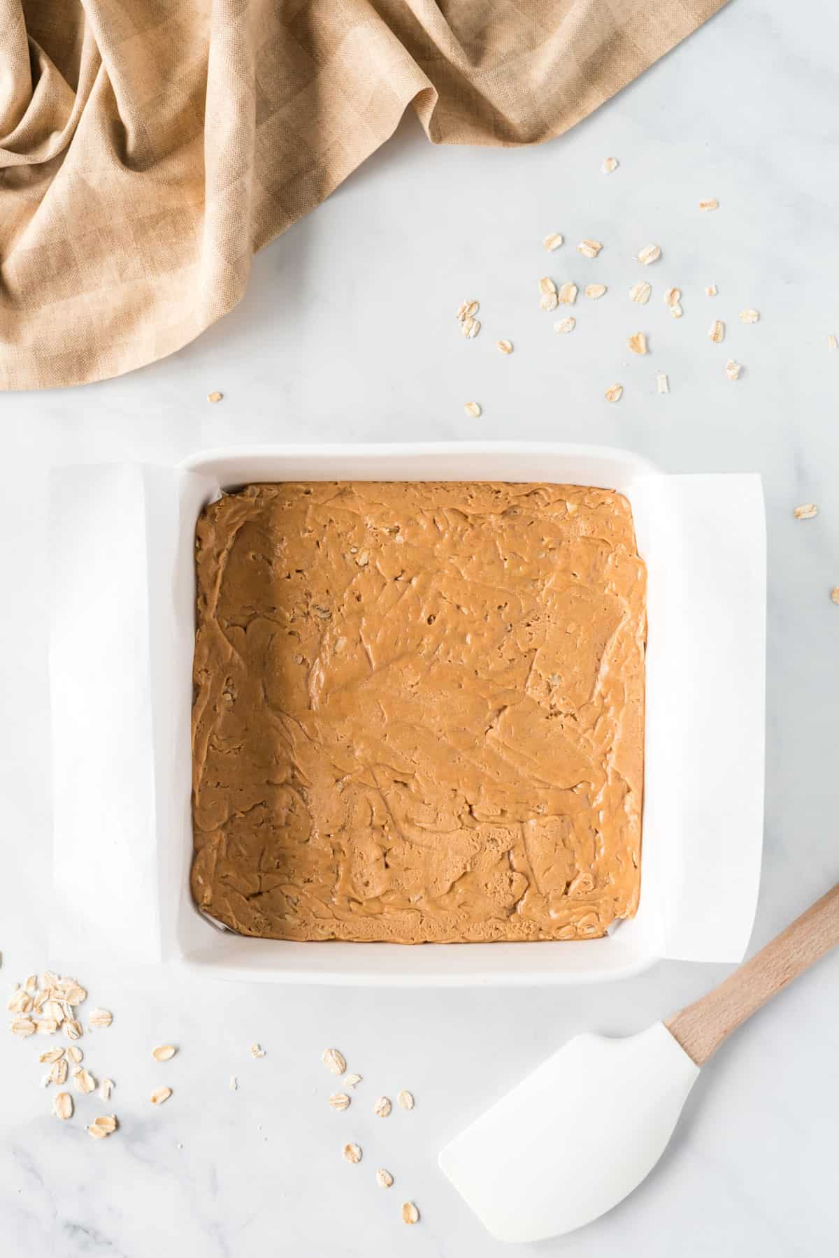 peanut butter protein bar filling pressed into a dish