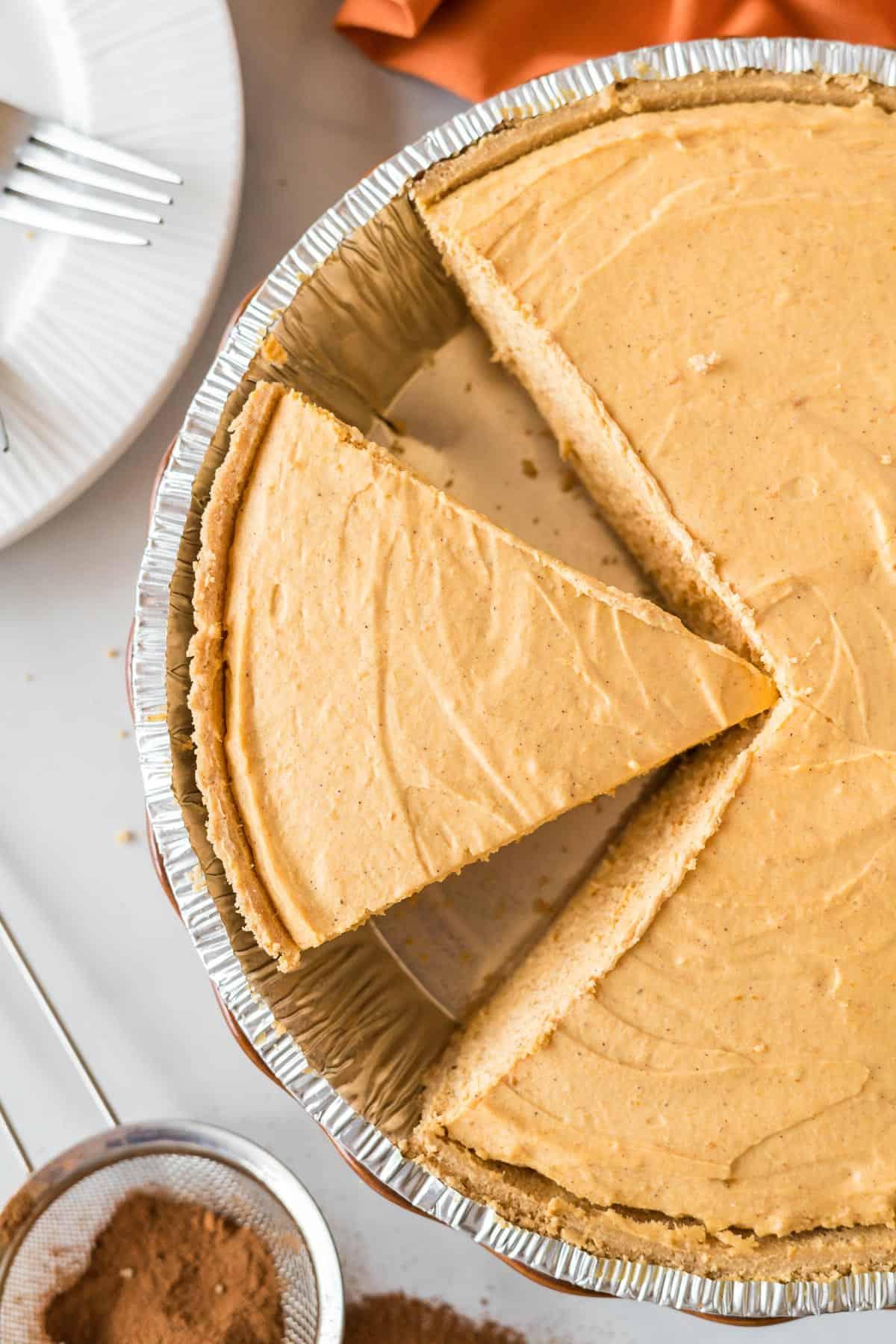 pumpkin cream pie slice cut in the pan