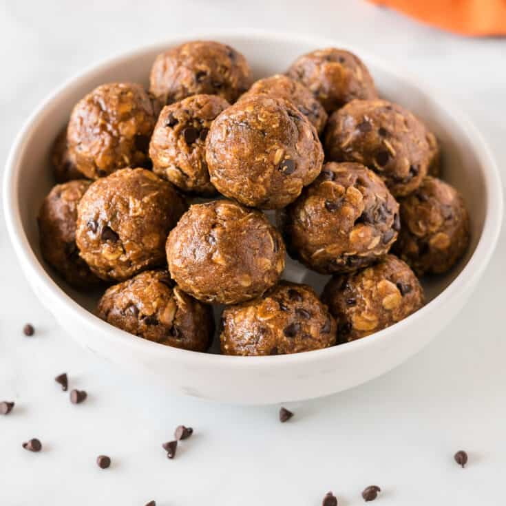 pumpkin energy balls stacked in a bowl